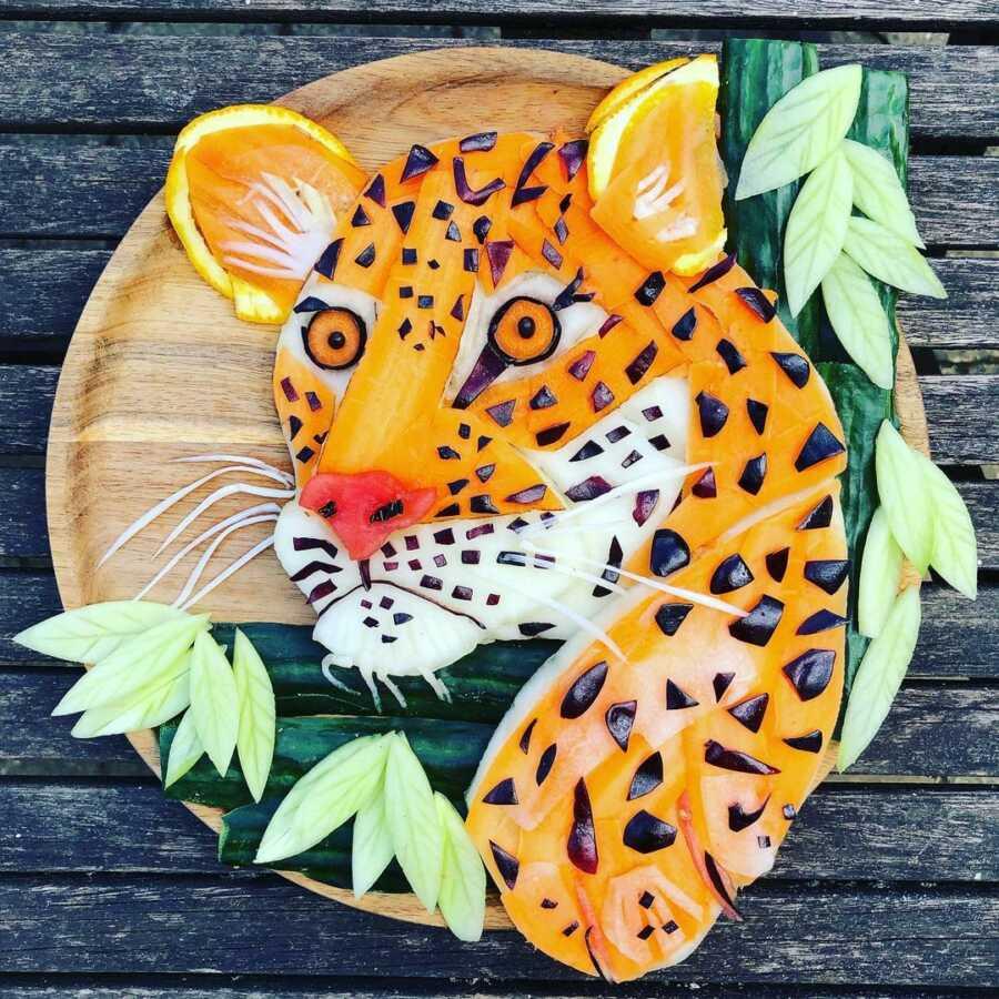 Edible food art platter scene of a cheetah.