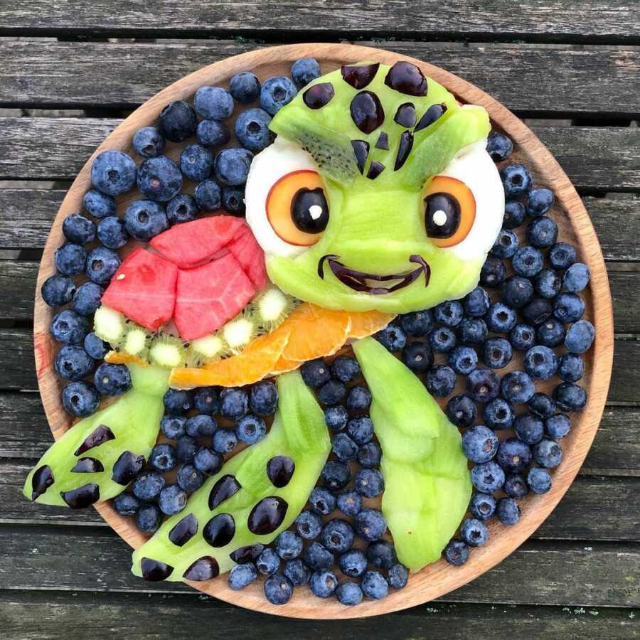 Edible food art fruit platter scene of Squirt, the baby sea turtle, in Disney's Finding Nemo.