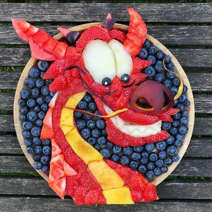 Edible food art fruit platter scene of Mushu from Disney's Mulan.