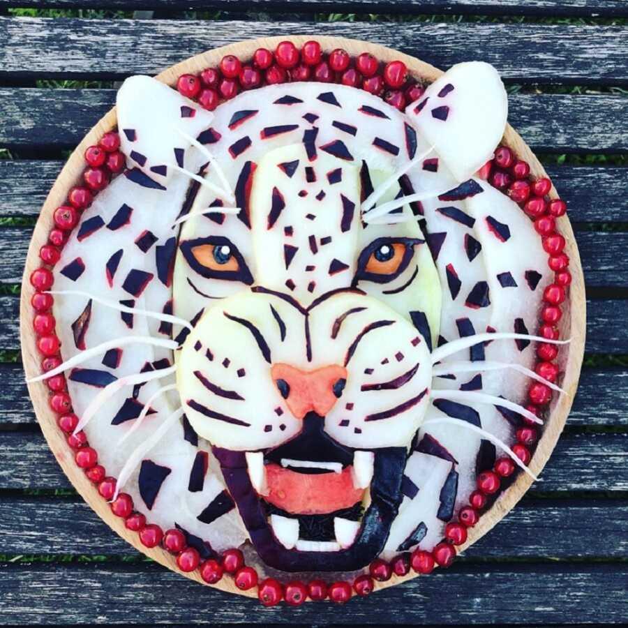 Edible food art fruit platter scene of a white tiger.