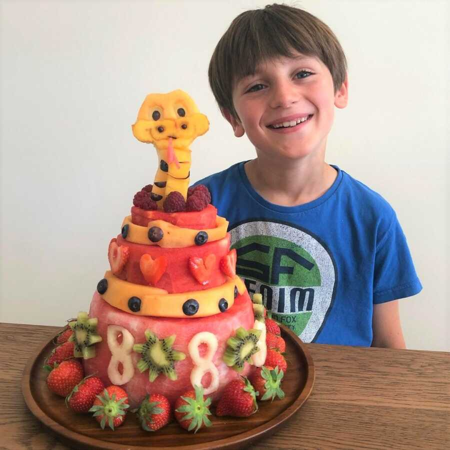 Eight-year-old's snake themed fruit cake for his birthday party.