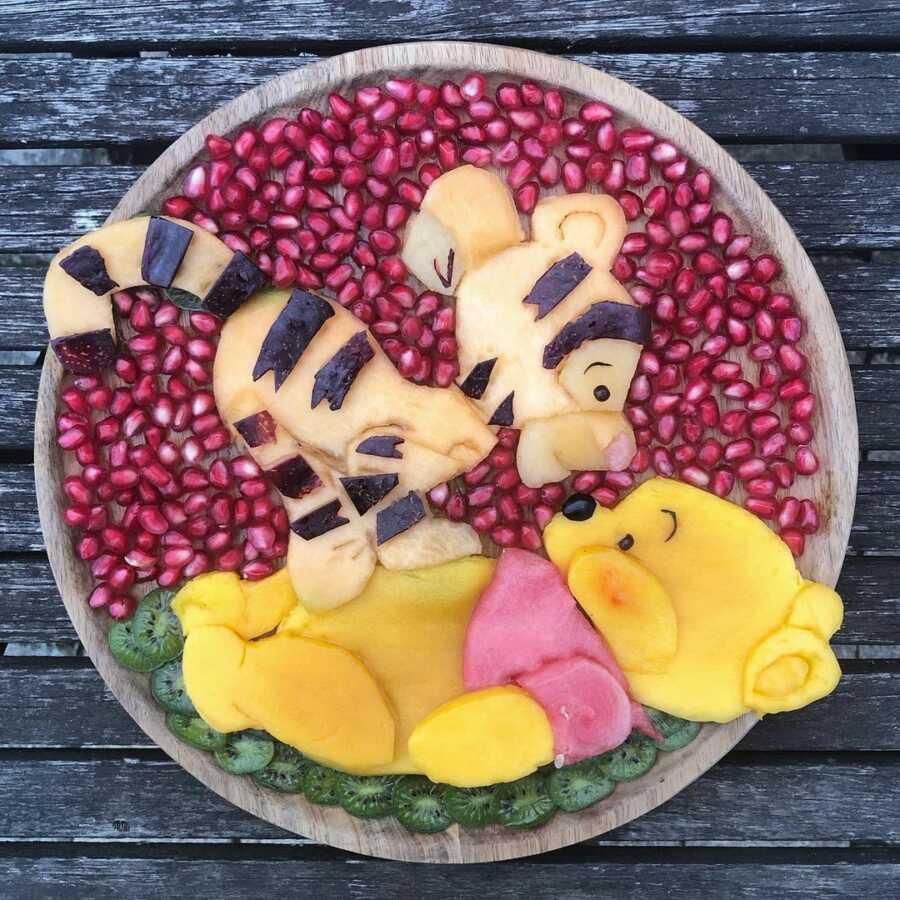 Edible food art fruit platter scene of Tigger and Winnie the Pooh.