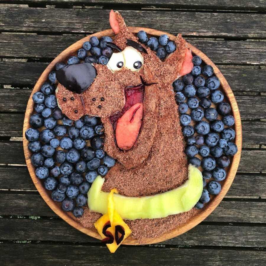 Edible food art fruit platter scene of Scooby Doo.