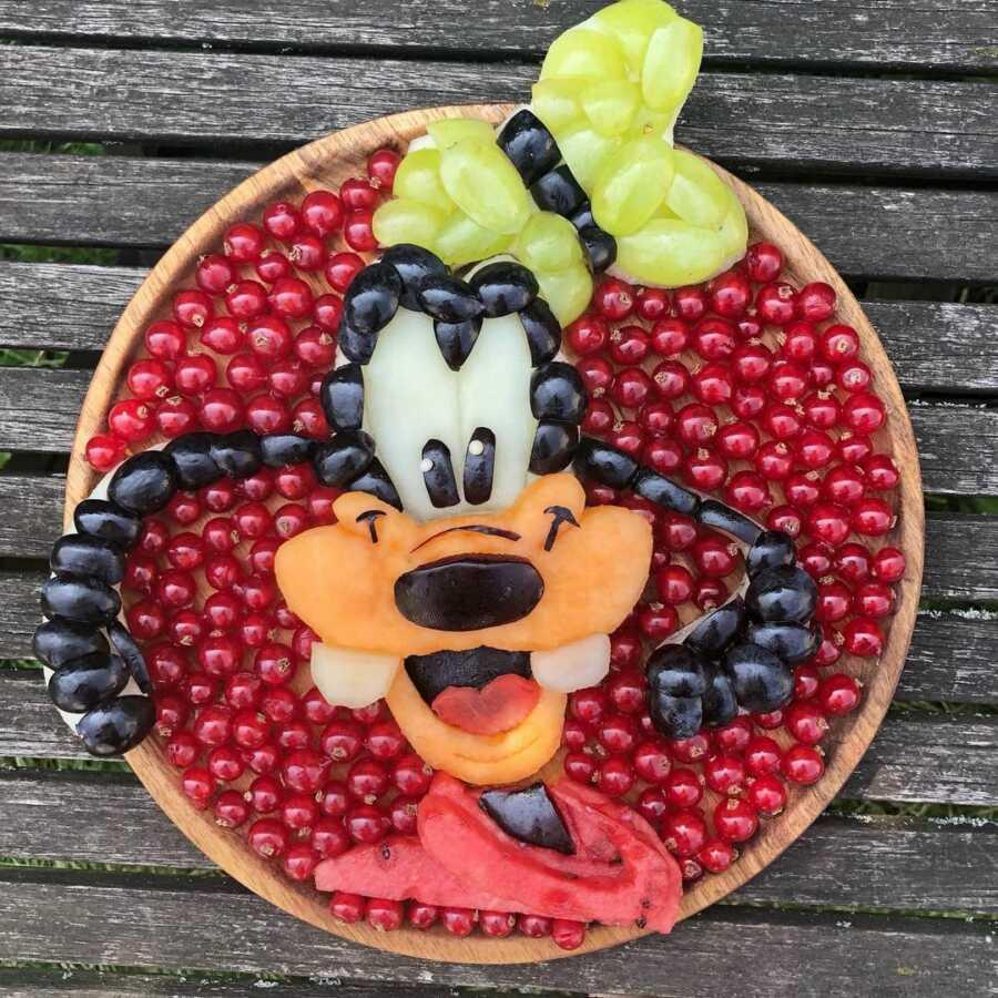 Edible food art fruit platter scene of Disney's Goofy.