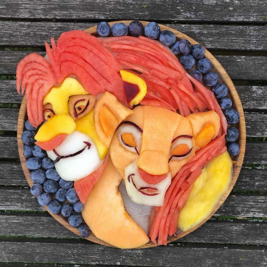 Edible food art fruit platter scene of Simba and Nala from Disney's The Lion King.