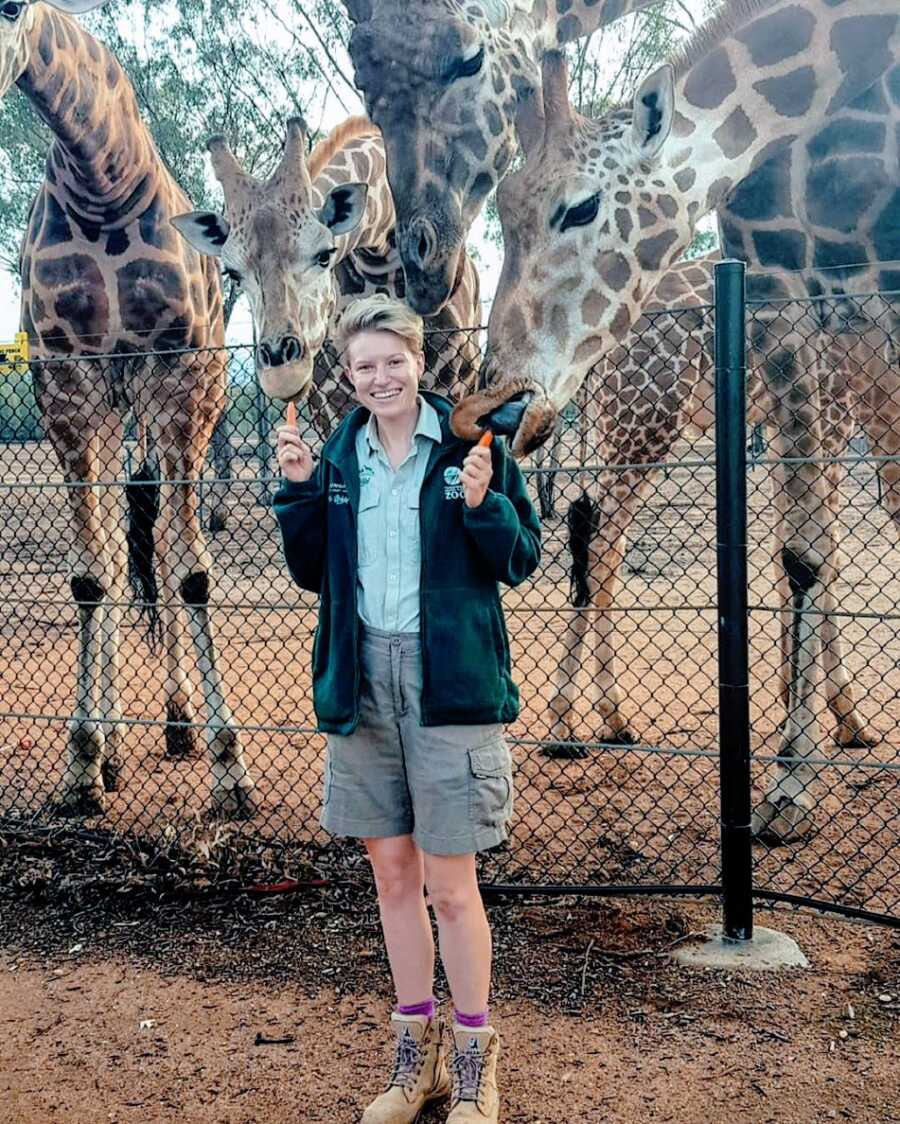 Woman at work as tour guide with giraffes