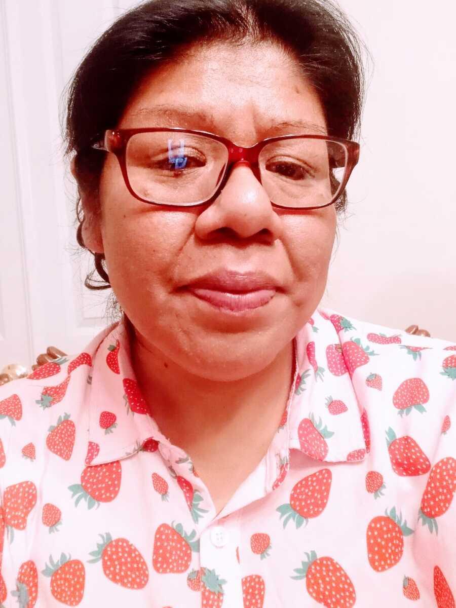 woman going through sobriety takes selfie