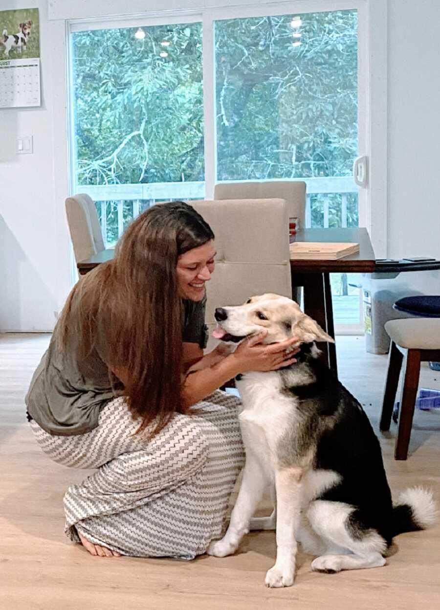 Woman struggling with mania pets big dog