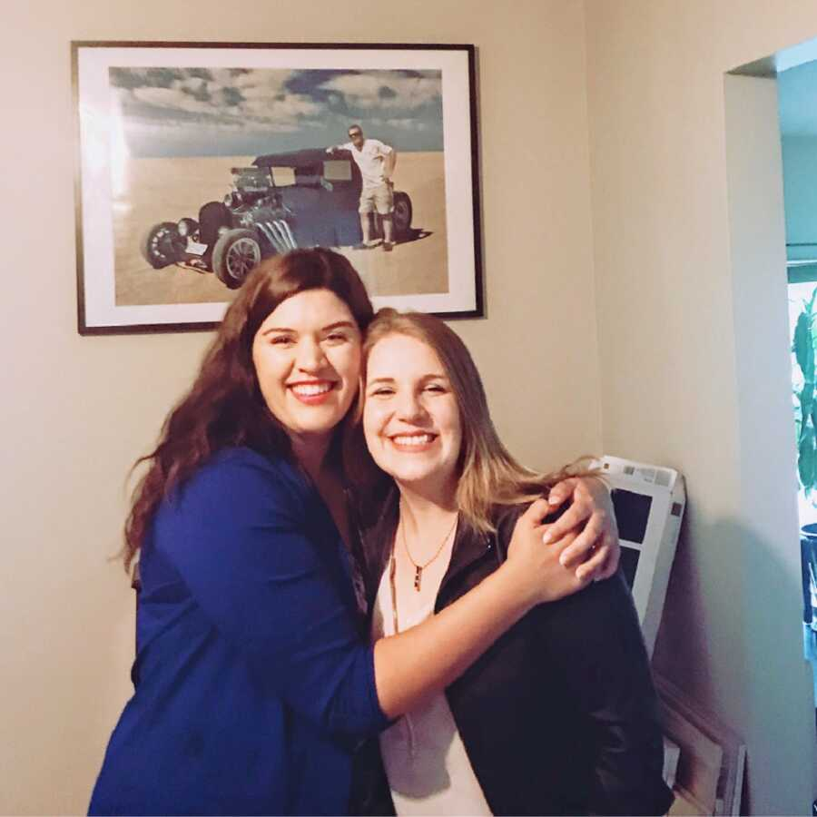 Woman with bipolar hugs friend who supported her