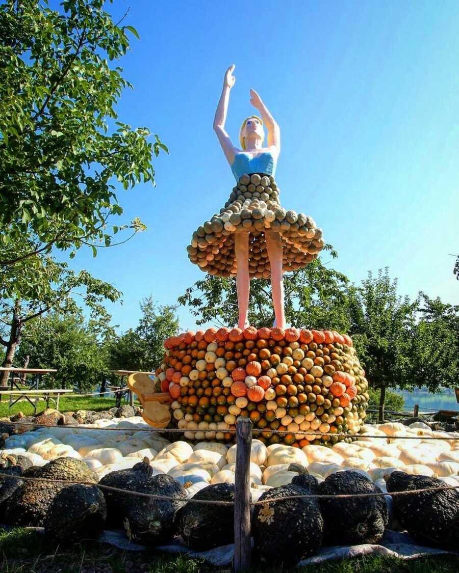 Giant music box ballerina creation at Jucker Farm's pumpkin exhibition.