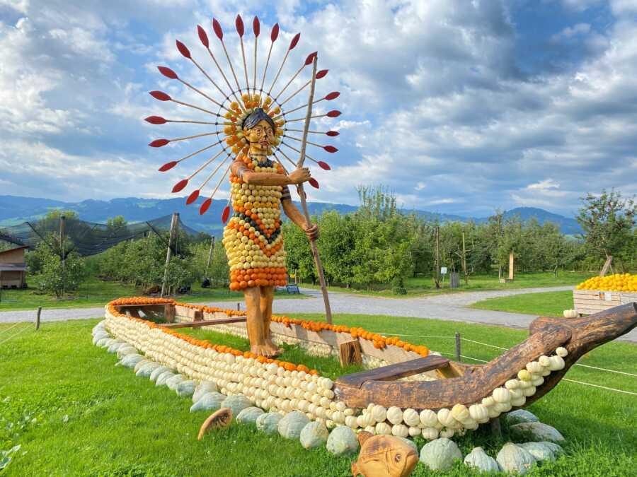 Giant Native American woman pumpkin creation at Jucker Farm's pumpkin exhibition.