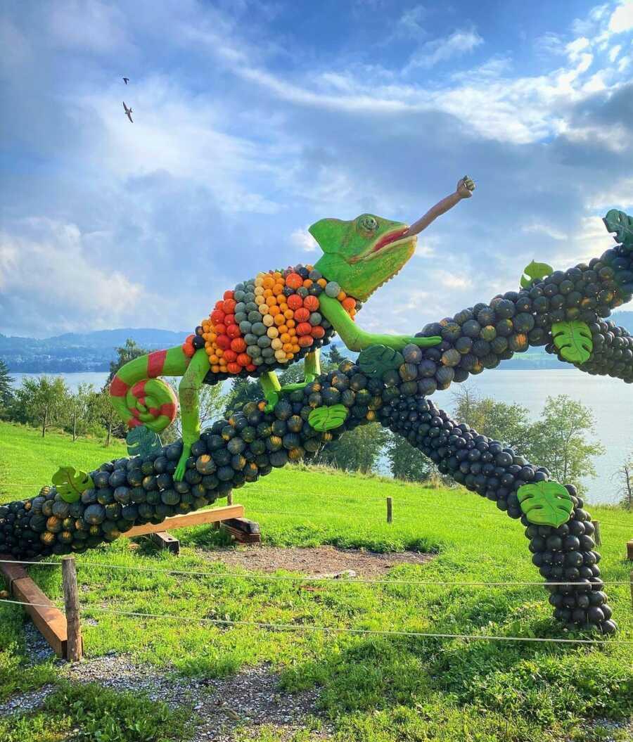 Giant chameleon creation at Jucker Farm's pumpkin exhibition.