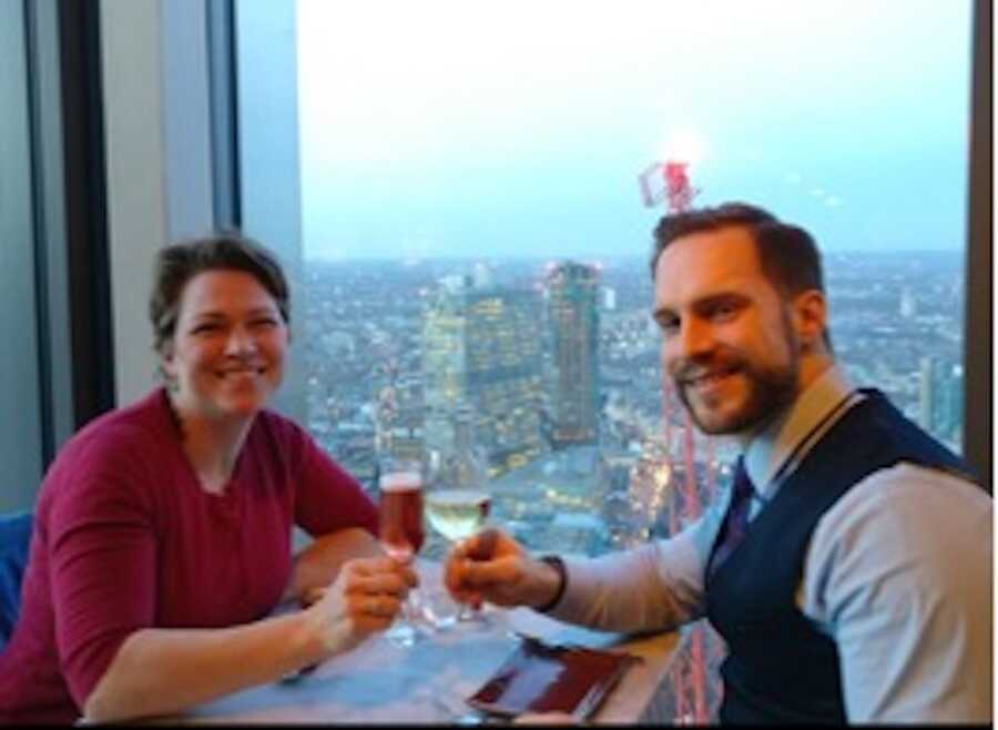 woman and her husband share drinks in restaurant