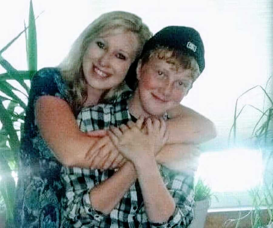 Woman hugs her brother from behind