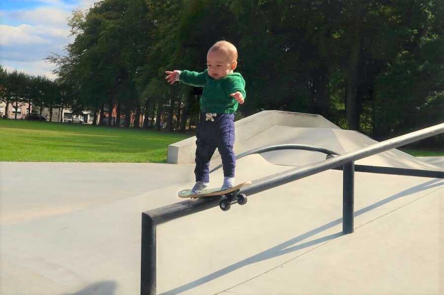 Dad photoshops baby performing difficult skateboarding trick.