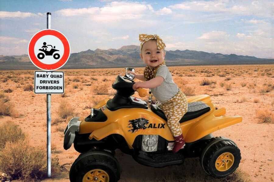 Dad photoshops baby riding a quad in the desert.