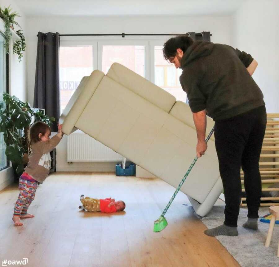 Toddler lifts couch for dad to sweep underneath, but they find the baby instead.