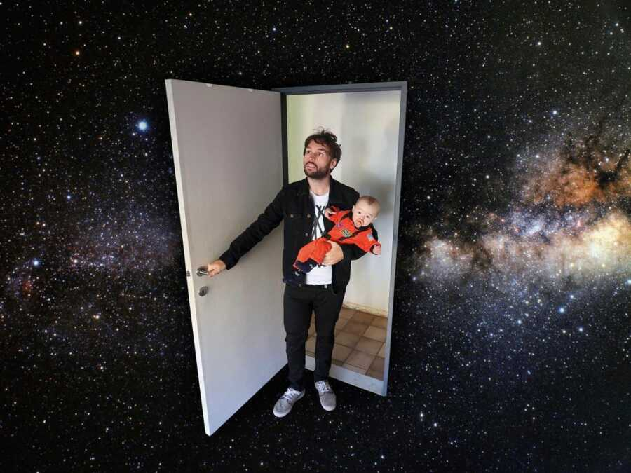 Dad photoshops stepping through a door into the galaxy while holding baby in space suit.