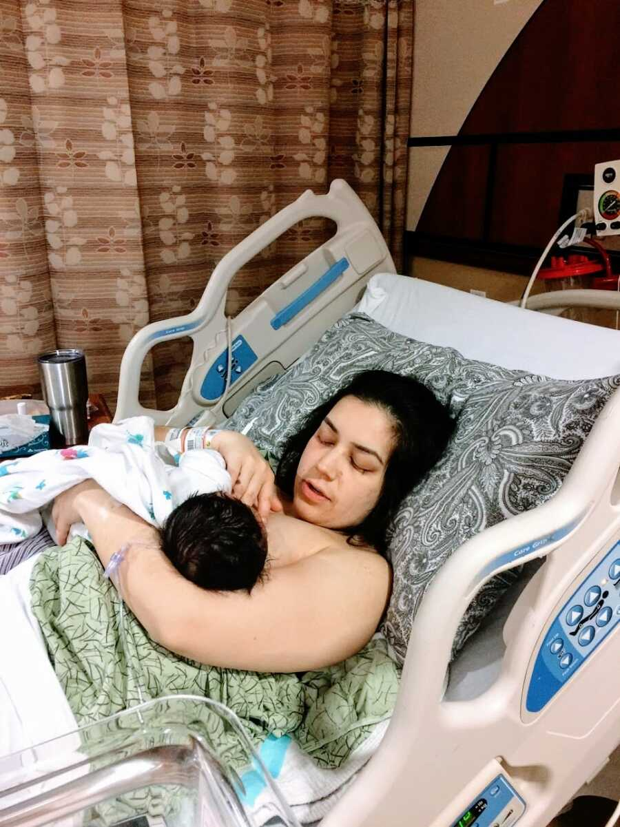 Mother lying in hospital bed with baby