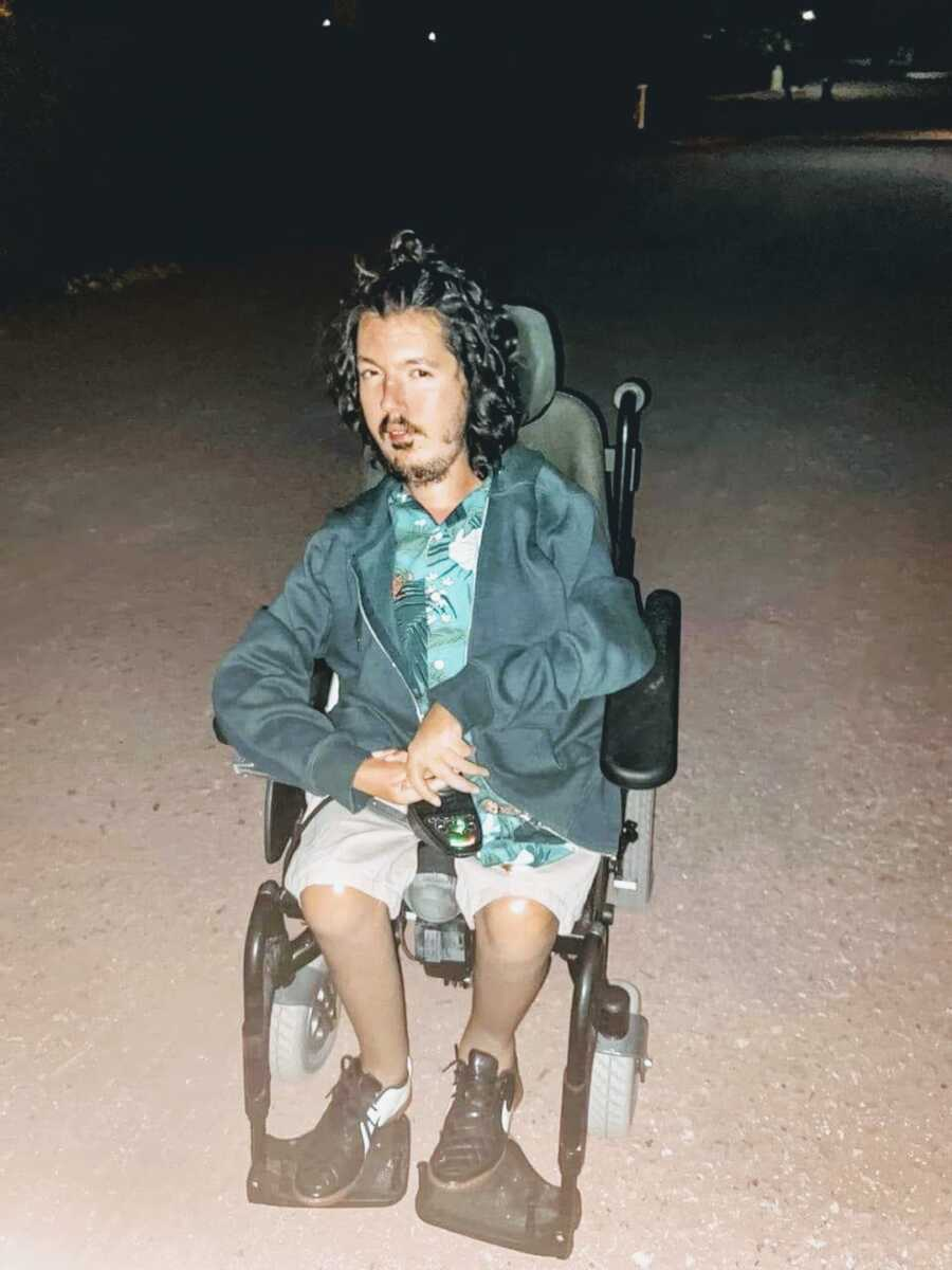 man with spinal muscular atrophy in wheelchair