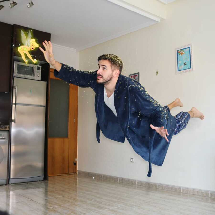 Man photoshops Disney character, Tinkerbell, into a scene of him covered in pixie dust, flying through his kitchen.