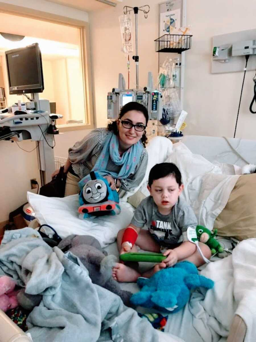 Special needs mom takes a photo with her son in the hospital while he receives an EEG to see why he's having seizures