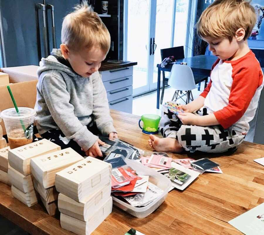 Mom shares photo of her two sons working on 'brave boxes' together, something the mom started to support birth moms