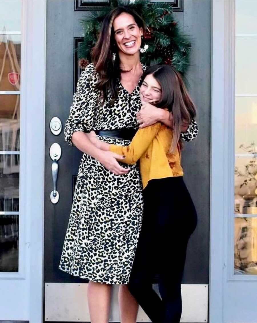 Girl mom hugs her oldest daughter after finding out about her act of kindness at school that day