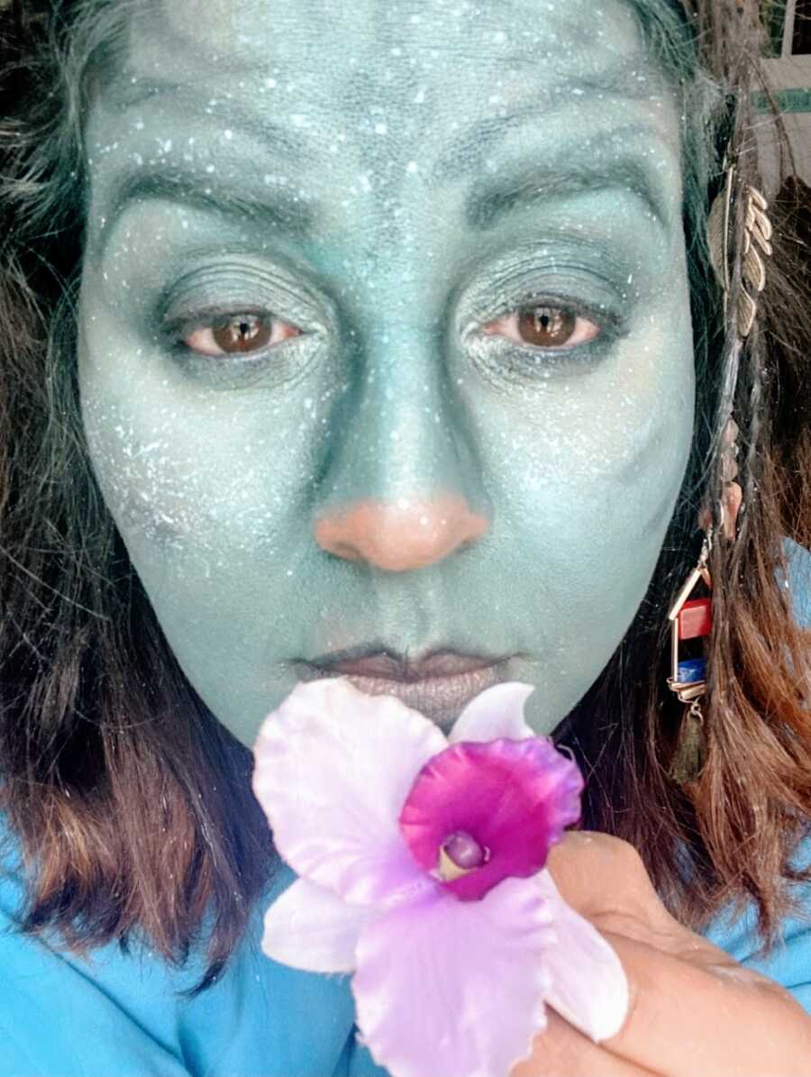 Mom takes a selfie showing off her incredible makeup skills for a DIY Halloween costume as an avatar