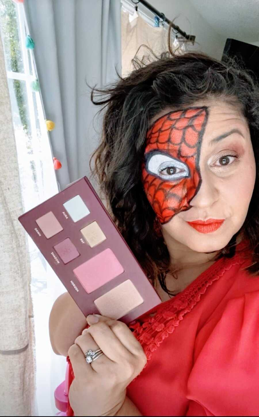 Mom takes a selfie of her impressive makeup Spiderman mask for a Halloween Costume