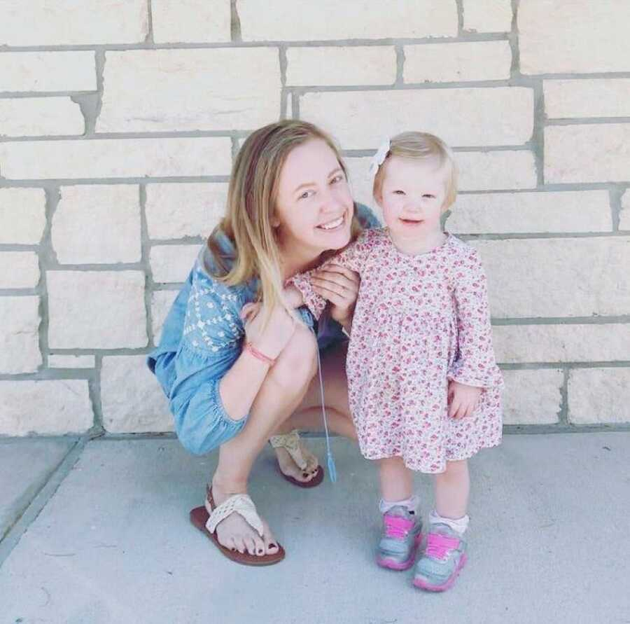 Mom and daughter take a photo together before church on a Sunday morning