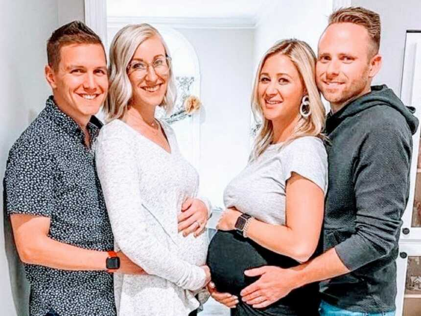 Two sisters pregnant at the same time take pictures with their husbands while showing off their belly bumps