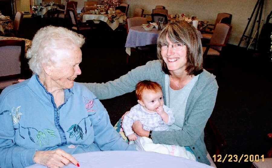 woman holds daughter next to mom with Alzheimer's