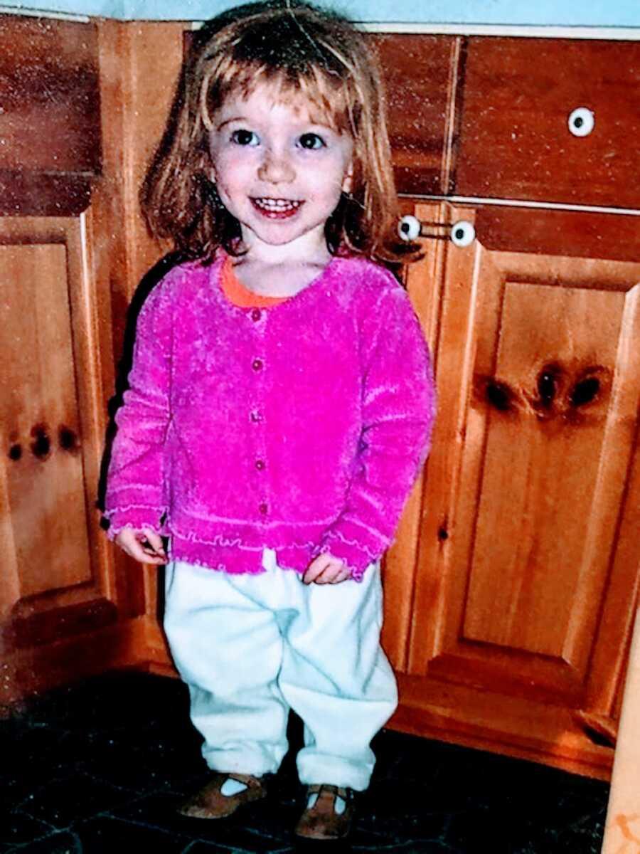 little girl with celiac wearing pink shirt