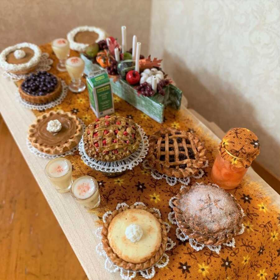 Miniature Thanksgiving pies made from sculpted clay.