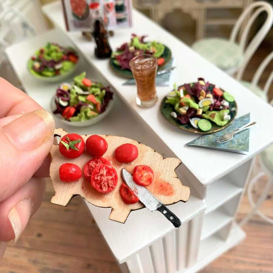 Miniature salads made from sculpted clay.