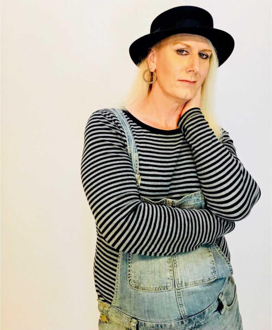 trans woman wearing overalls, feeling comfort in gender identity
