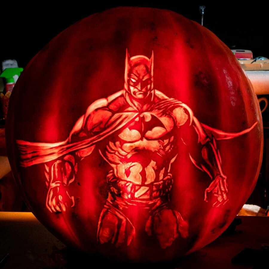 Incredible pumpkin carving of Batman, created by Maniac Pumpkin Carvers.