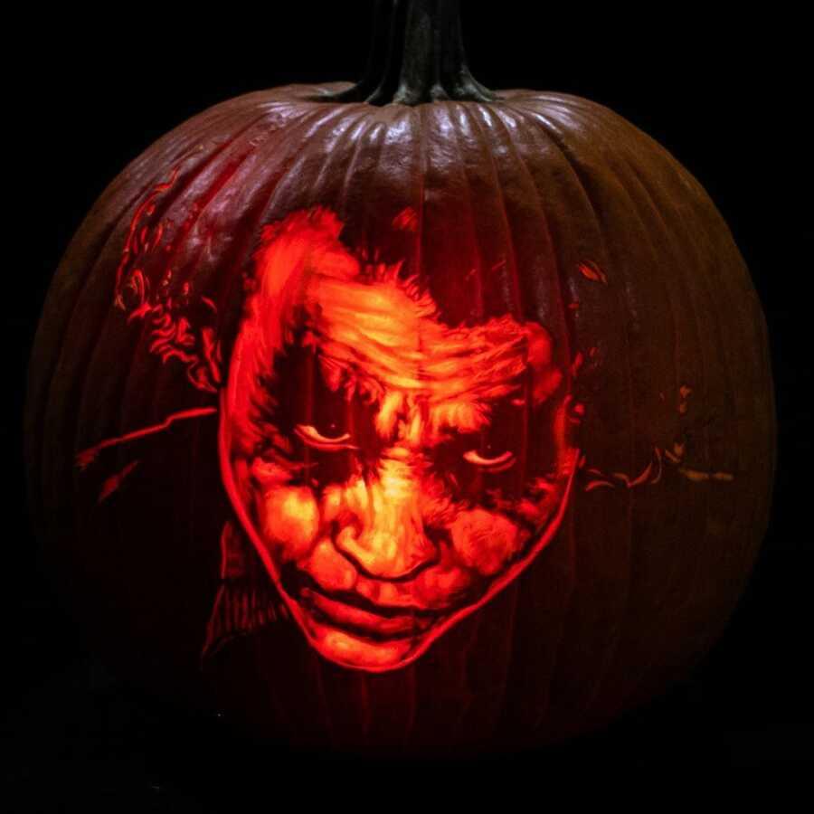 Incredible pumpkin carving of the Joker, created by Maniac Pumpkin Carvers.