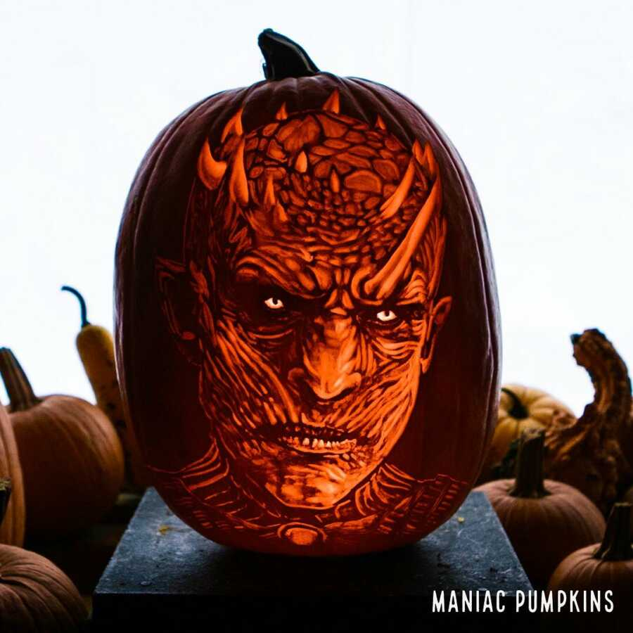 Detailed pumpkin carving of Darth Maul, created by Maniac Pumpkin Carvers.