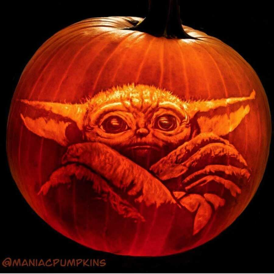 Incredible pumpkin carving of The Child, created by Maniac Pumpkin Carvers.