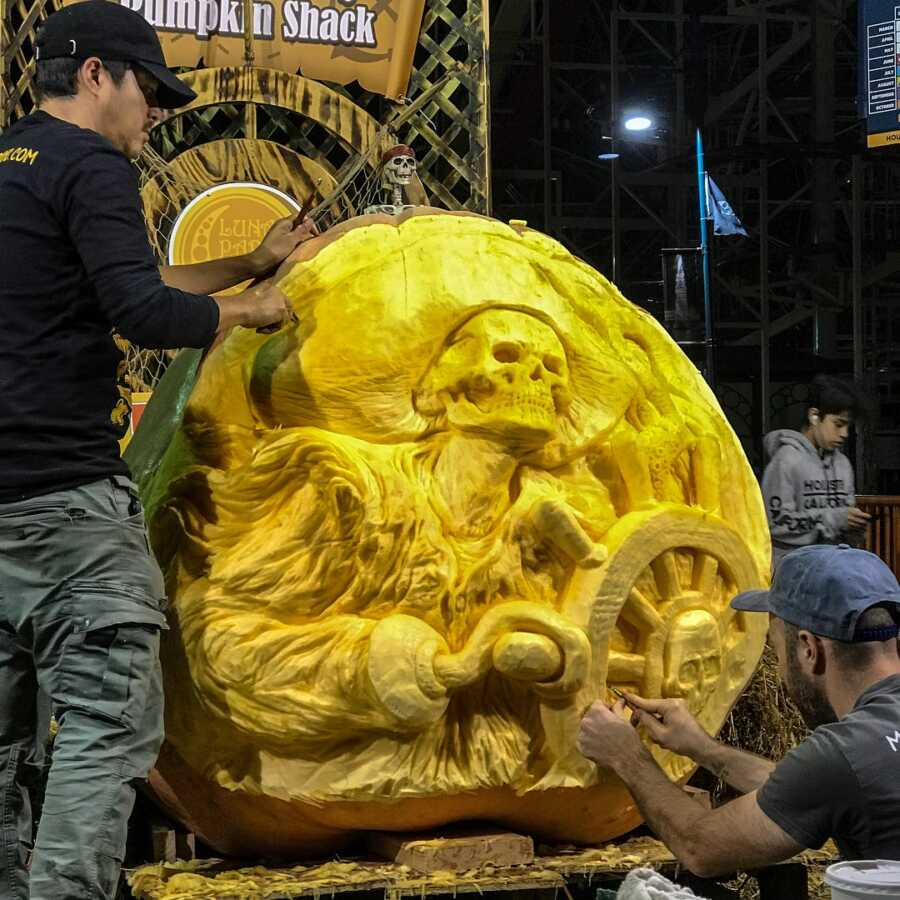 Giant pumpkin sculpting of a skeleton pirate, created by Maniac Pumpkin Carvers.