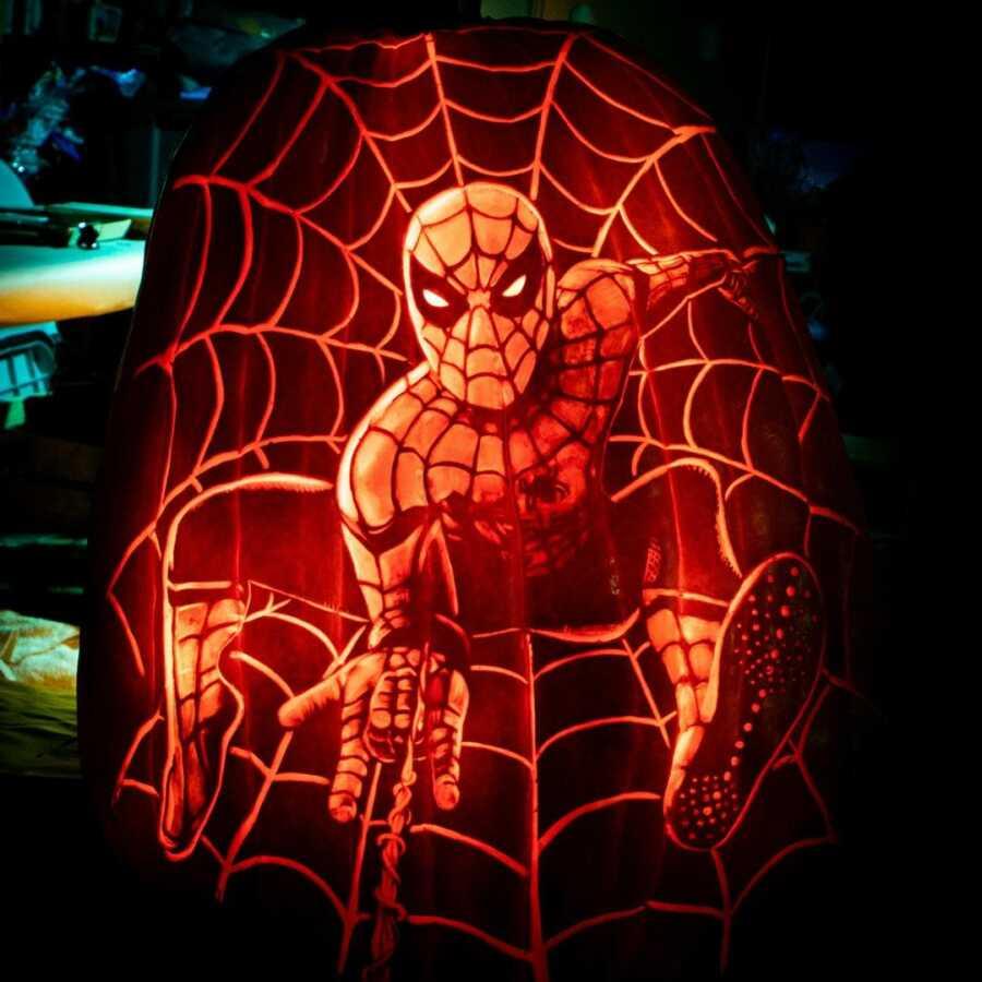 Detailed Spiderman pumpkin carving, created by Maniac Pumpkin Carvers.