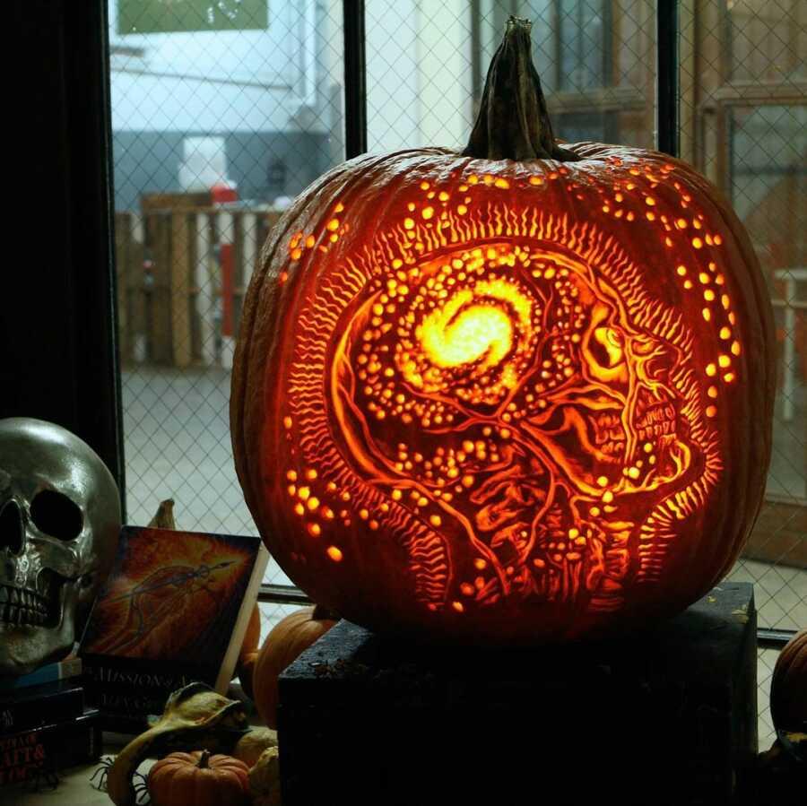 Incredible pumpkin carving design, created by Maniac Pumpkin Carvers.