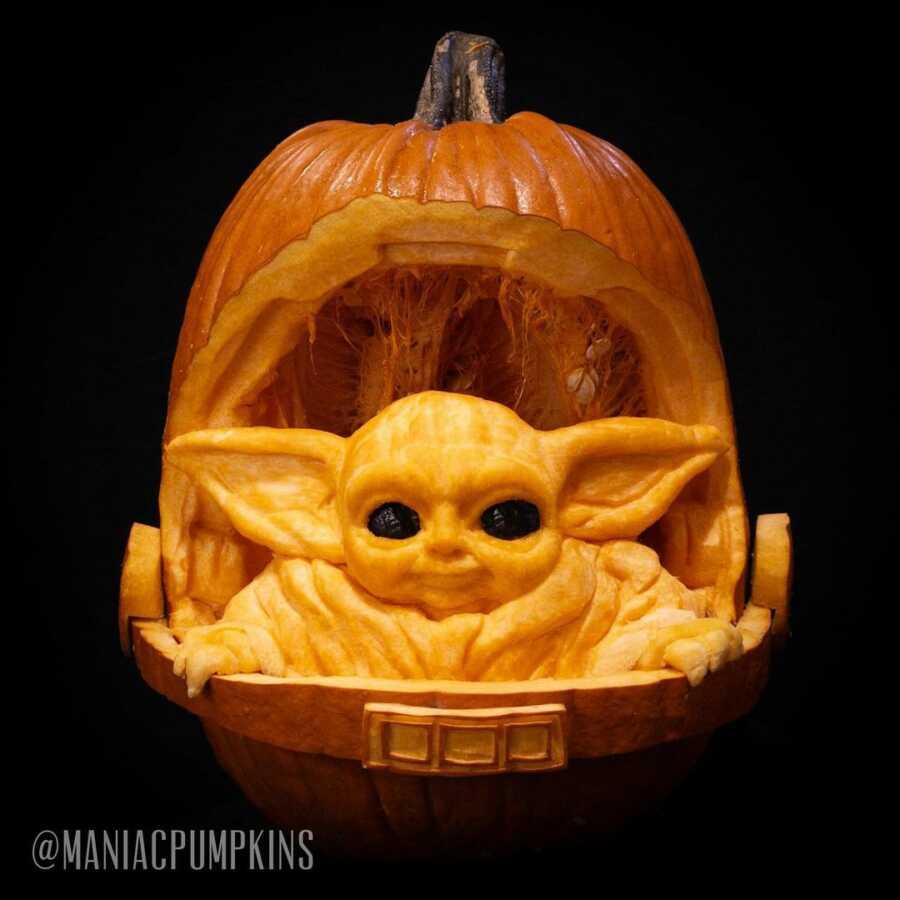 Pumpkin sculpture of The Child, created by Maniac Pumpkin Carvers.