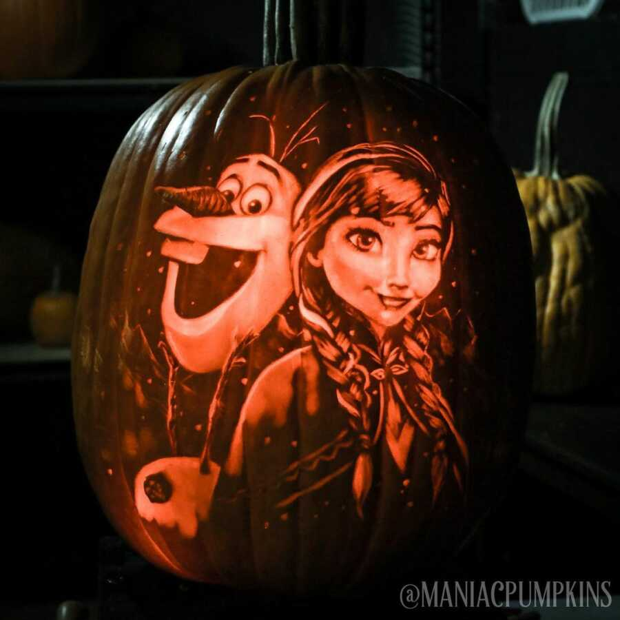 Detailed pumpkin carving of Olaf and Anna, created by Maniac Pumpkin Carvers.