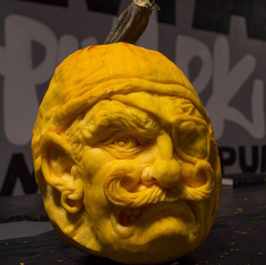 Pumpkin sculpture of pirate face, created by Maniac Pumpkin Carvers.