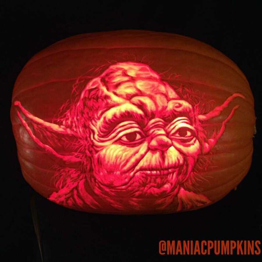 Amazing pumpkin carving of Yoda, created by Maniac Pumpkin Carvers.