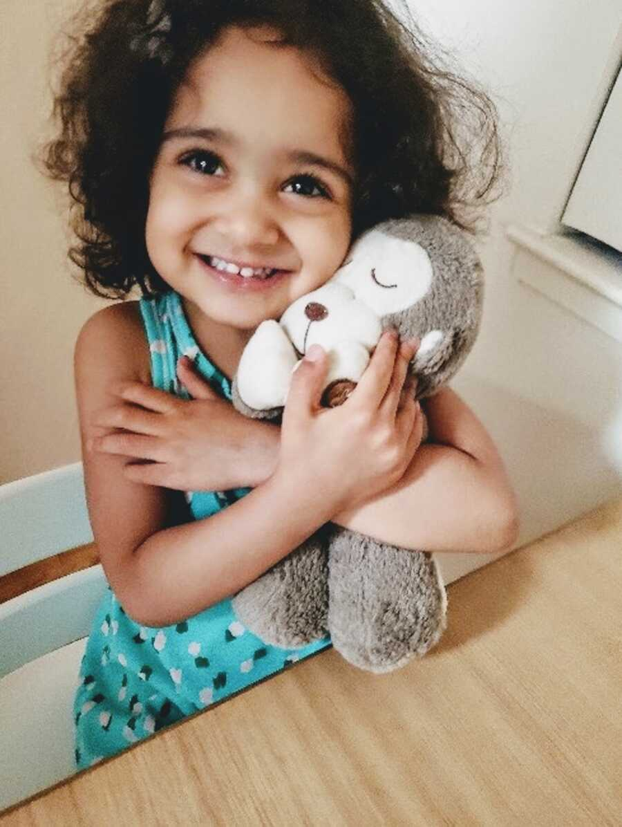 daughter holding her favorite toy she about to give