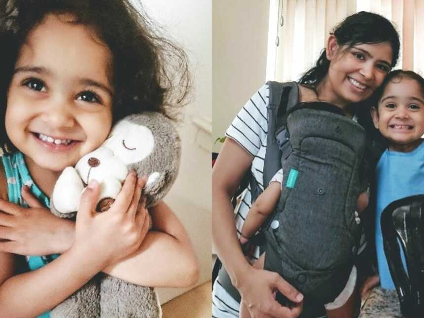 A young girl holds her favorite toy and mom and daughter together